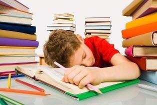 Kid-Asleep-with-Textbook